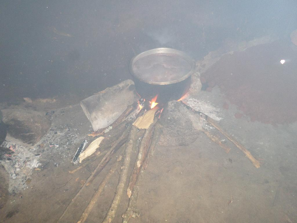 School Kitchen With Open Fire And Resulting Indoor Smoke